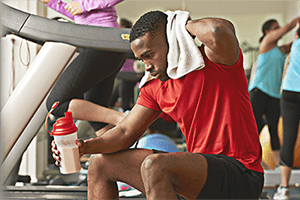 Targeted nutrition. A man in the gym drinking a protein shake.