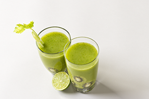 Nutritional beverages. Two green smoothies containing kiwi.