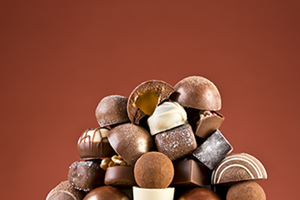 Confectionery. A large pile of chocolates.